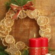 Two candles and christmas decorations, on golden background — Stock Photo #16270895