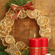 Stock Photo: Two candles and christmas decorations, on golden background