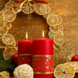 Two candles and christmas decorations, on golden background — Stock Photo #16270933