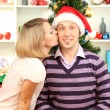 Young happy couple near  Christmas tree at home — Stock Photo