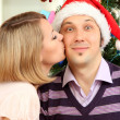 Romantic kiss under mistletoe — Stock Photo