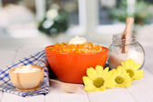 Useful pumpkin porridge in color plate on wooden table on window background — Stock Photo