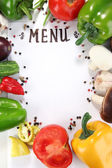 Menu surrounded by products and vegetables isolated on white — Stock Photo