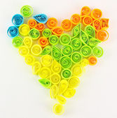 Colorful quilling laid out in form of heart isolated on white — Zdjęcie stockowe