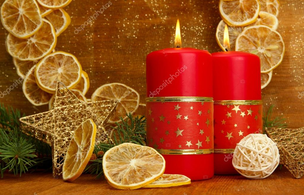 Two candles and christmas decorations, on golden background  Stock Photo #16270911