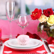Table setting in honor of Valentine's Day on room background — Stock Photo