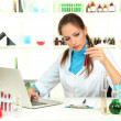 Stock Photo: Young female scientist in laboratory