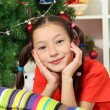 Little girl dreaming near christmas tree — Stock Photo #16304043