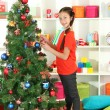 Little girl decorating christmas tree — Stock Photo #16304145