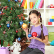 Little girl decorating christmas tree — Stock Photo #16304161
