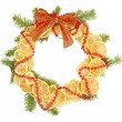 Christmas wreath of dried lemons with fir tree and bow isolated on white — Photo