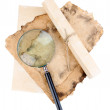 Old paper with magnifying glass isolated on white — Stock Photo