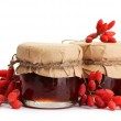 Ripe barberries and jars of jam isolated white — Stock Photo