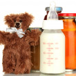 Baby food, bottle of milk and juice with teddy bear isolated on white — Stock Photo #16305887