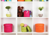 Color wicker boxes on cabinet shelves — Foto Stock