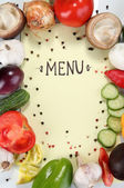 Menu surrounded by products and vegetables on yellow paper — Stok fotoğraf