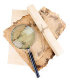 Old paper with magnifying glass isolated on white — Photo