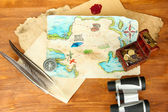 Map of treasures on wooden background — Stock Photo