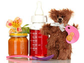 Baby bottle with fresh juice, puree and teddy bear isolated on white — Stock Photo
