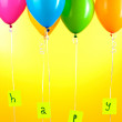 Colorful balloons keeps word happy on yellow background — Stock Photo
