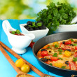 Colorful composition of delicious pizza, vegetables and spices on blue wooden background close-up - Stock Photo