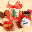 Cookies for Santa: Conceptual image of ginger cookies, milk and christmas decoration on light background - Stock fotografie