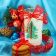 Cookies for Santa: Conceptual image of ginger cookies, milk and christmas decoration on blue background - Stock fotografie