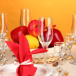 Table setting in red tones on color  background - Stock fotografie