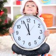 Little boy with clock in anticipation of New Year — Foto de stock #16326527