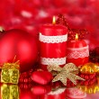 Red candle with christmas decoration on bright background — Foto de Stock