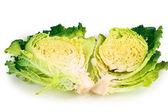 Fresh cut savoy cabbage isolated on white — Stock Photo