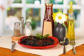 Black spaghetti on bright background — Stock Photo