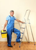 Handyman in house near the wall — Foto de Stock