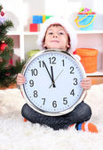 Little boy with clock in anticipation of New Year — Photo