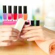 Manicure process in beauty salon, close up — Stock Photo #16596611