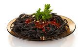 Black spaghetti isolated on white — Stock Photo