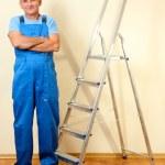 Handyman in house near the wall — Stock Photo #16600157