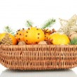 Christmas composition in basket with oranges and fir tree, isolated on white - Foto Stock