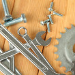 Machine gear, metal cogwheels, nuts and bolts on wooden background — Zdjęcie stockowe
