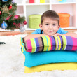 Little boy sleeping under Christmas Tree waiting for Santa Claus to come - ストック写真