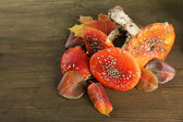 Red amanitas, on wooden background — Stock Photo