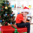 Little boy with big gift and clock in anticipation of New Year — Stock Photo
