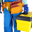 Male builder in blue overalls with yellow suitcase isolated on white — Stock Photo