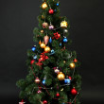 Decorated Christmas tree isolated on black — Stock Photo