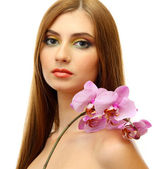 Portrait of sexy young woman with pink orchid flower, isolated on white — Stock Photo