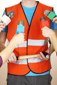 Conference meeting microphones and road worker — Stock Photo