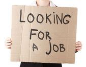Geschäftsfrau hält zeichen suchen — Stockfoto