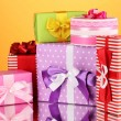 Colorful gifts on orange background - Photo