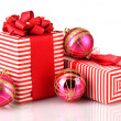Colorful red gifts with Christmas balls isolated on white — Stock Photo #16769689