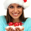 Beautiful young woman holding snow with christmas balls, isolated on white — Stock Photo